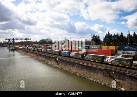 Europe, Germany, North Rhine-Westphalia, Cologne, the container terminal at the Rhine harbour in the town district - Stock Photo