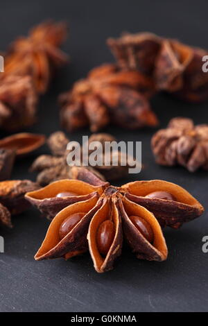 Star Anise on a black wood background - Stock Photo