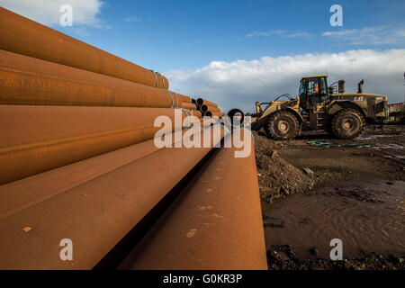 pipes stacked in a orderly fashion - Stock Photo