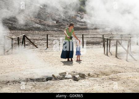 Tourist woman & child / family at Solfatara volcano steam & sulfurous fumes Pozzuoli, Naples Italy; Campi Flegrei - Stock Photo
