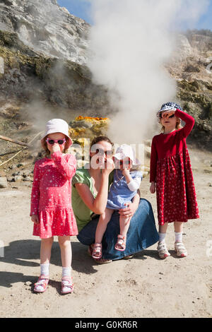 Tourist woman children family at Solfatara volcano steam & sulfurous fumes Pozzuoli, Naples Italy; Campi Flegrei - Stock Photo