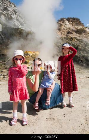 Tourist woman children family at Solfatara volcano steam & sulfurous fumes Pozzuoli, Naples Italy; Campi Flegrei - Stock Photo