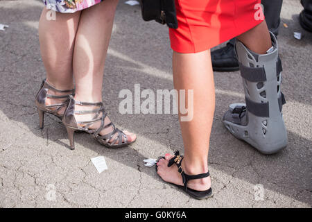 Aintree, Liverpool. 2 May 2016. One woman wears a splint at Aintree Racecourse, Liverpool. - Stock Photo