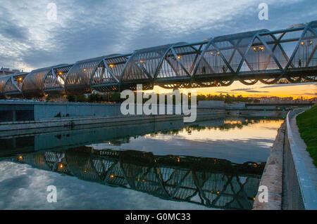 Perrault bridge and river Manzanares at dusk. Madrid Rio park, Madrid, Spain. - Stock Photo