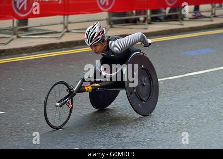 Wheelchair competitor, 2016 Virgin Money London Marathon, Canary Wharf, London, United Kingdom - Stock Photo