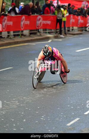 Woman Wheelchair competitor, 2016 Virgin Money London Marathon, Canary Wharf, London, United Kingdom - Stock Photo