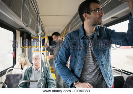 Man standing riding bus - Stock Photo