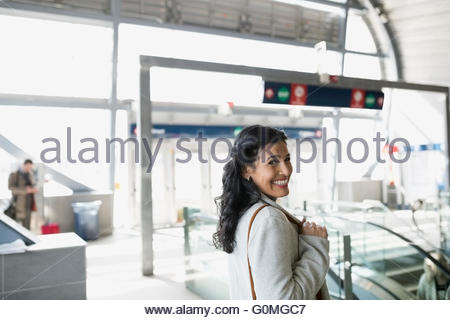 Portrait smiling woman at train station - Stock Photo