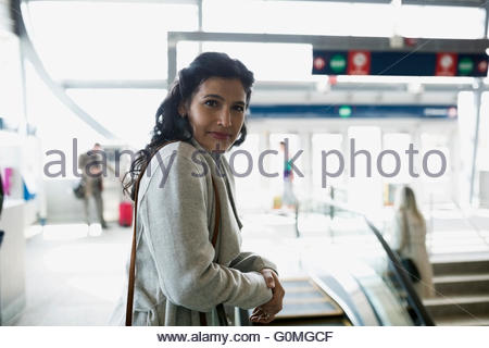 Portrait confident woman at train station - Stock Photo