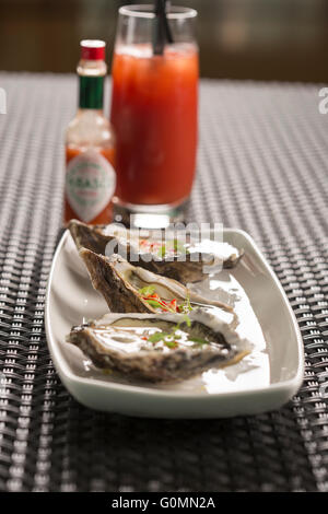 Maldon oysters with chilli, ginger & rice wine vinegar - Stock Photo