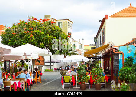 Dining out in one of historical streets of Zona Velha, Funchal's Old Town, Madeira, in the evening - Stock Photo