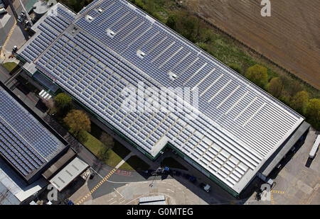 Photovoltaic Solar Panels On Factory Roof Stock Photo