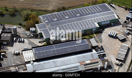 aerial view of solar panels on a factory roof, north of England, UK - Stock Photo