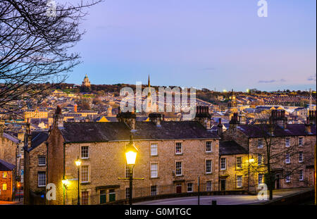 Evening view over Lancaster England from Castle Hill with the Ashton Memorial on the skyline