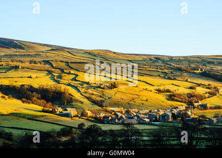 Winter morning looking at the village of Gunnerside in Swaledale in the Yorkshire Dales National Park England - Stock Photo