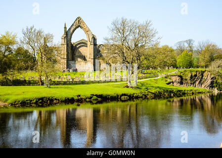 Looking across the River Wharfe to the ruins of Bolton Abbey, North Yorkshire - Stock Photo