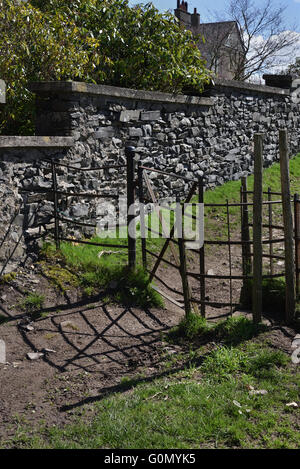 Metal kissing gate on a footpath. on the outskirts of Sedbergh Town, Cumbria, Yorkshire Dales, England, UK. - Stock Photo