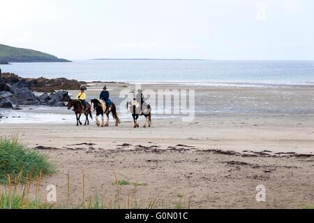 Horse riding on Narin strand beach near Portnoo, County Donegal, Ireland - Stock Photo