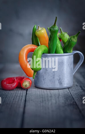 Chili pepper in a Cup on the table - Stock Photo