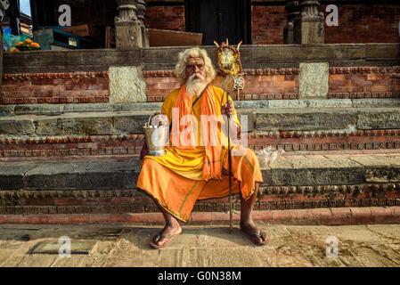 Wandering  sadhu baba (holy man) in ancient Pashupatinath Temple - Stock Photo