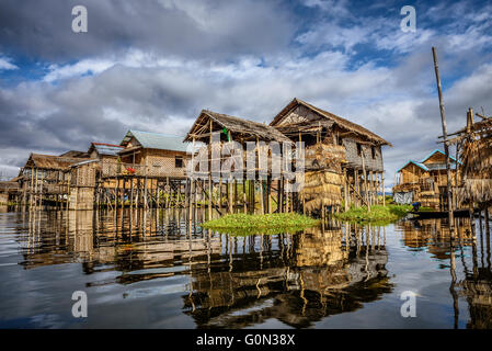 Wooden houses on piles inhabited by the tribe of Inthar, Inle Lake, Myanmar - Stock Photo