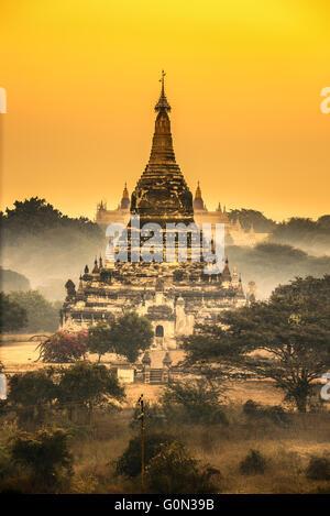 Scenic sunrise above a buddhist temple in Bagan, Myanmar - Stock Photo