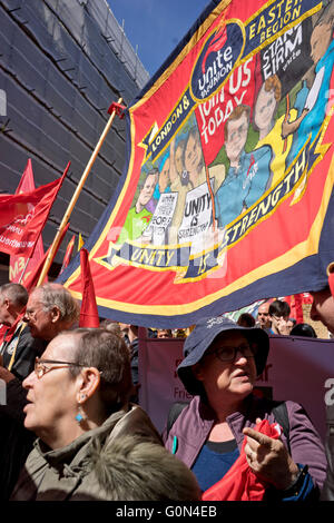 London,UK.1st May 2016. Demonstrators display banners and badges during International Workers May Day rally. - Stock Photo