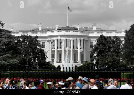 The White House in black and white with crowed in color. - Stock Photo