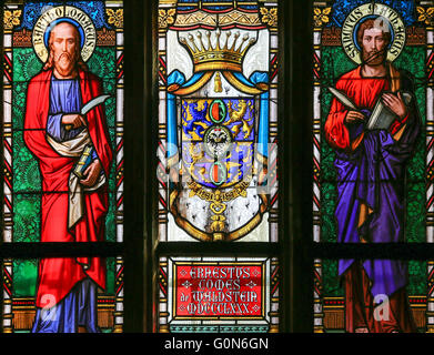Stained Glass window in St. Vitus Cathedral, Prague, depicting Saint Matthew the Evangelist and Saint Bartholomew - Stock Photo