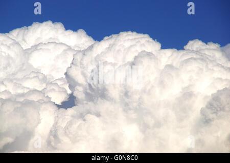 A cumulonimbus cloud. White clouds in the blue sky. - Stock Photo