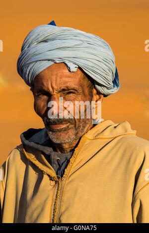 Camel driver portrait in the Erg Chebbi sand dunes - Stock Photo