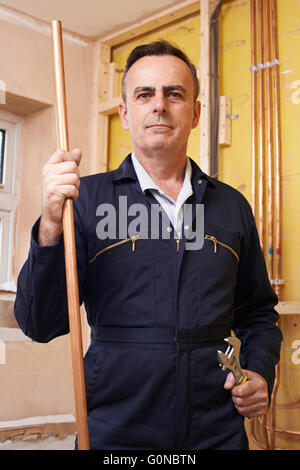Portrait Of Plumber Working In House - Stock Photo