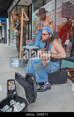 Asheville, North Carolina - A jug band plays for donations on a downtown street. - Stock Photo