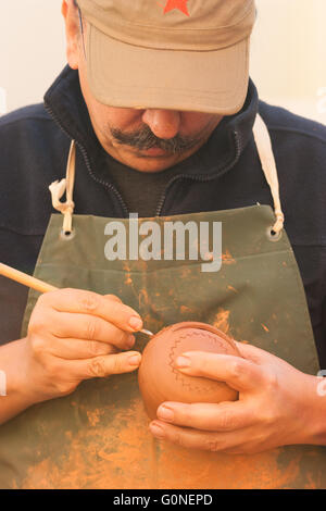 Potter working, Valencia. - Stock Photo