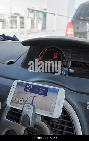 Do-it-yourself navigation system in a car - Stock Photo