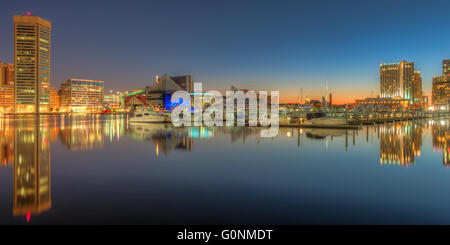 Part of the skyline of Baltimore, Maryland reflected in the waters of the Patapsco River in the Inner Harbor before - Stock Photo
