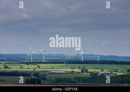 4 giant wind turbines (eyesore?) tower over farmland fields in scenic countryside - Knabs Ridge wind farm near Harrogate, - Stock Photo
