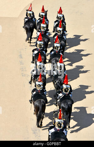 Looking down from above Household Cavalry at Hyde Park Corner returning from changing the guard ceremony at Horse - Stock Photo