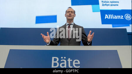 Munich, Germany. 04th Apr, 2016. CEO of Allianz SE, Oliver Baete, stands at the podium ahead of the Allianz general assembly in Munich, Germany, 04 April 2016. Photo: PETER KNEFFEL/dpa/Alamy Live News
