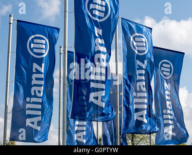 Munich, Germany. 04th Apr, 2016. Blue flags written with 'Allianz' wave ahead of the Allianz general assembly in Munich, Germany, 04 April 2016. Photo: PETER KNEFFEL/dpa/Alamy Live News