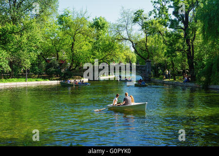 People rowing on the lake at Cismigiu garden park, in central Bucharest, Romania. - Stock Photo