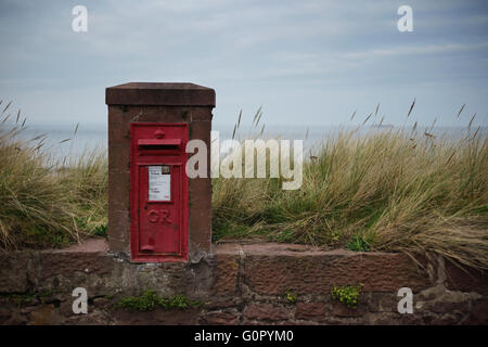 A traditional old red King George post box by the beach in North Berwick, Scotland. - Stock Photo