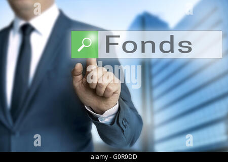 Fonds (in german fund) browser is operated by businessman. - Stock Photo