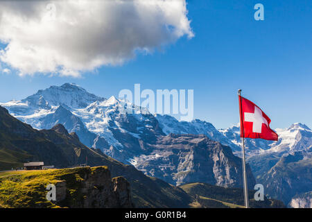 Stunning view of the Jungfrau and mountain range of Bernese alps from Mannlichen cablecar station, Switzerland. - Stock Photo
