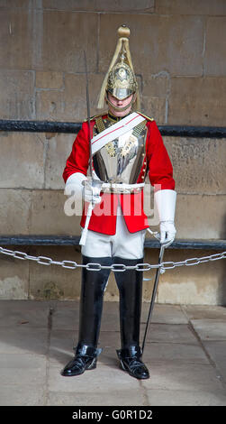 WINDSOR - APRIL 17: Unidentified man, guard protecting entrance to the Whitehall palace on April 17, 2016 in London, - Stock Photo