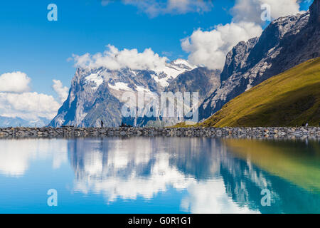 Stunning view of Wetterhorn with reflection in beautiful pond on the Bernese Oberland on a sunny summer day, Switzerland. - Stock Photo