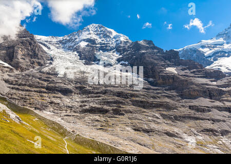 Close view of the famous peak Monch and the Eiger glacier of the swiss Alps on Bernese Oberland in Switzerland, - Stock Photo
