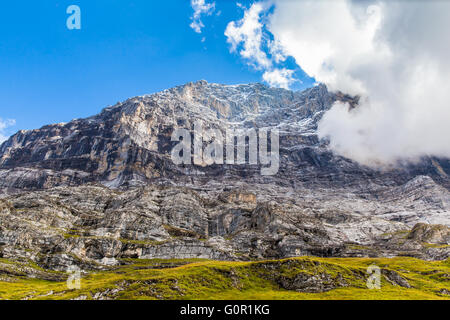 Close view of the famous Eiger north face on a summer day, swiss alps on Bernese Oberland of Switzerland. - Stock Photo