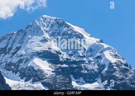 Close view of the famous peak Monch of the swiss Alps on Bernese Oberland in Switzerland. It is one of the main - Stock Photo