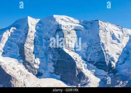 Close view of the Piz Palu from Diavolezza on a sunny day, a famous peak of the Bernina massive in swiss Canton - Stock Photo